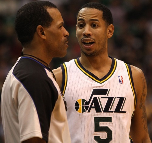 Rick Egan    The Salt Lake Tribune   Utah Jazz point guard Devin Harris (5) has a few words with the referee, in NBA action in Salt Lake City, Monday, February 20, 2012.