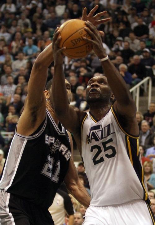 Rick Egan    The Salt Lake Tribune   Utah Jazz power forward Paul Millsap (24) goes to the hoop, as  San Antonio Spurs center Tim Duncan (21) defends  in NBA action in Salt Lake City, Monday, February 20, 2012.