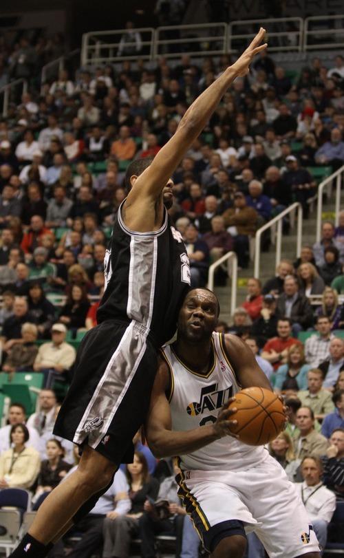 Rick Egan    The Salt Lake Tribune   Utah Jazz power forward Paul Millsap (24)gets around San Antonio Spurs center Tim Duncan (21) in NBA action in Salt Lake City, Monday, February 20, 2012.