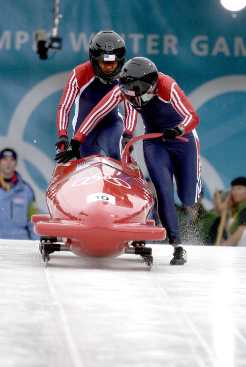 Paul Fraughton   Tribune file photo Americans Jill Bakken, right, and Vonetta Flowers push off for their first run of the inaugural women's bobsled competition at the Utah Olympic Park. They ultimately won the gold medal.