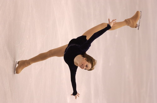 Leah Hogsten   Tribune file photo Figure skater Sarah Hughes of the United States performs her short program at the Delta Center. Hughes finished in fourth place, but later vaulted to an unexpected gold medal.