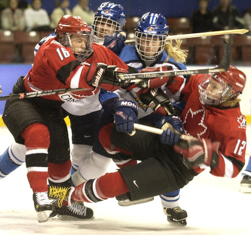 Ryan Galbraith   Tribune file photo Canada's Jayna Hefford and Lori Dupuis block Finland's Paivi Salo and Saija Sirvio during a women's hockey semifinal game that Canada won 7-3 at the E Center in West Valley City, to advance to the gold-medal game against the United States.