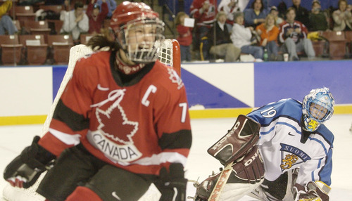 Ryan Galbraith   Tribune file photo Finland goaltender Tuula Puputti watches Canada's Cassie Campbell celebrate another goal during the Canadians' 7-3 victory in a women's semifinal hockey game at the E Center in West Valley City. The Canadians advanced to the gold-medal game against the U.S.