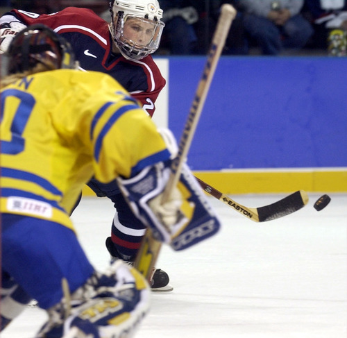 Ryan Galbraith   Tribune file photo American Katie King takes a shot at Swedish goaltender Kim Martin in the United States' 4-0 semifinal victory that earned a date against rival Canada in the women's hockey gold medal game.