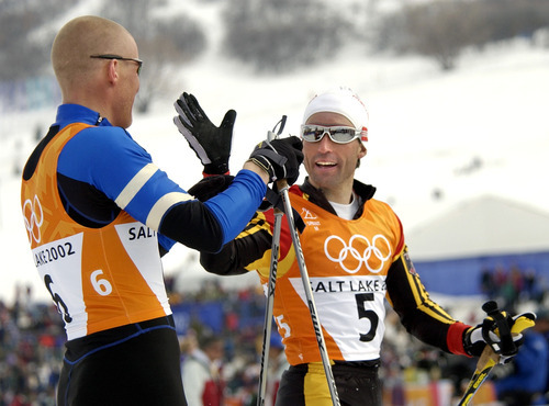 Al Hartmann   Tribune file photo Norway's Tor Arne Hetland, left, high-fives Germany's Peter Schlickenrieder after taking gold and silver, respectively, in the men's cross country sprint race at Soldier Hollow.