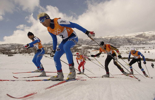 Francisco Kjolseth   Tribune file photo Italy's Cristian Zorzi leads the pack up a hill during a semifinal of the men's cross country sprint race at Soldier Hollow. Zorzi won the semifinal, and wound up with the bronze medal.