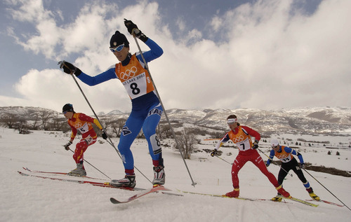 Francisco Kjolseth   Tribune file photo Skiers race up a hill in the consolation final of the women's cross country sprint at Soldier Hollow.