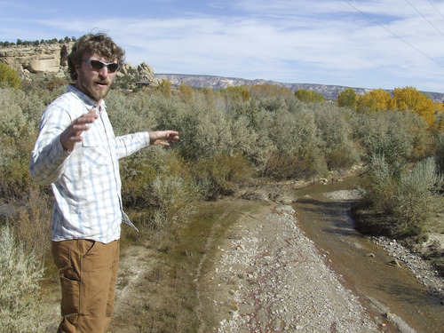 Brandon Loomis   The Salt Lake Tribune Canyon Country Youth Corps Program Manager Alexander Nees shows a spot on Oct. 24 along Birch Creek, a tributary to the Escalante River, where non-native Russian olive trees have crowded out willows and other native plants -- and with them grazing cattle and wildlife. The youth workers in his conservation corps are among many private and public agencies working to restore the Escalante watershed.