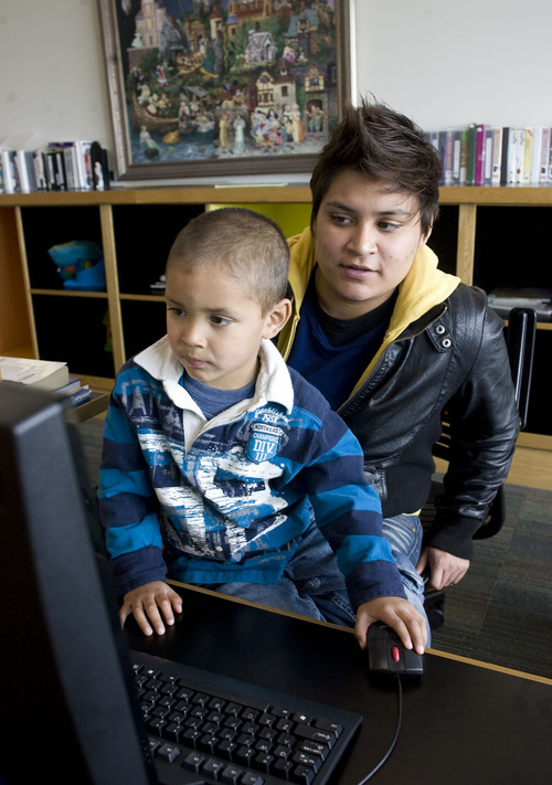 Al Hartmann  |  The Salt Lake Tribune A task force studying how to help more Utah women graduate from college recommends more support for campus based initiatives, such as those that would help young parents finish classwork. Carina Ortiz, a social work major at Utah Valley University studies is able to study while keeping her son, Joey, 4, busy in the Gibson Family Study room.