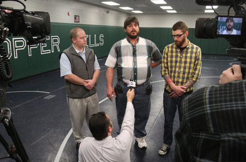 Rick Egan  |  The Salt Lake Tribune  Bret Sackett, center, flanked by his son Grant and a wrestling coach John Hatch, talks to reporters Thursday at Copper Hills High School about the status of his younger son, Chance. Bret Sackett accidentally shot 15-year-old Chance on Saturday at their home in West Jordan. Chance's classmates at Copper Hills High are raising money to help pay for Chance's care at Primary Children's Medical Center.