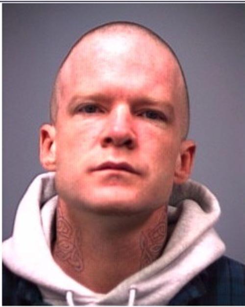 Courtesy of Iron County Sheriff's Office Troy James Knapp, 2001 parole photo from a California burglary conviction.