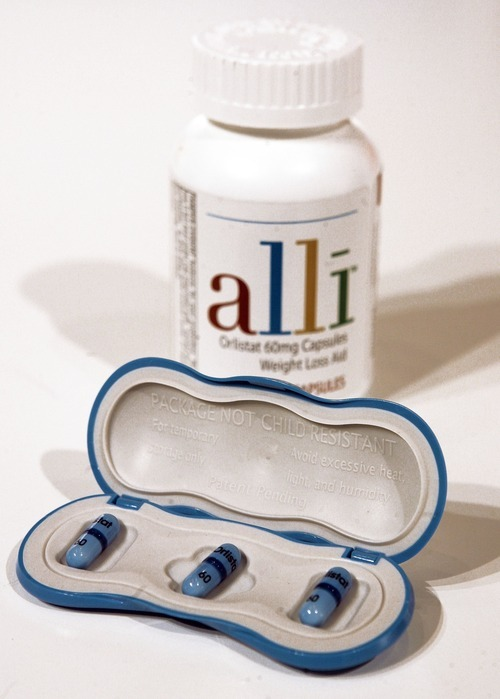 FILE - This May 22, 2007 file photo shows GlaxoSmithKline's alli, the first over-the-counter diet pill approved by the Food and Drug Administration, in New York. The battle of the bulge so far has been a big, fat failure for U.S. drugmakers. But that hasn't stopped them from trying. For nearly a century, scientists have struggled to come up with a diet pill that helps people lose weight without causing side effects that range from embarrassing digestive issues to dangerous heart problems. (AP Photo/Richard Drew, File)