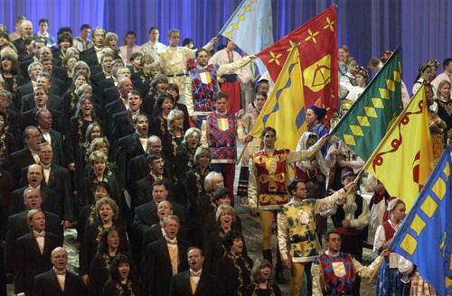 The Mormon Tabernacle Choir sings alongside costumed dancers at a rehearsal of