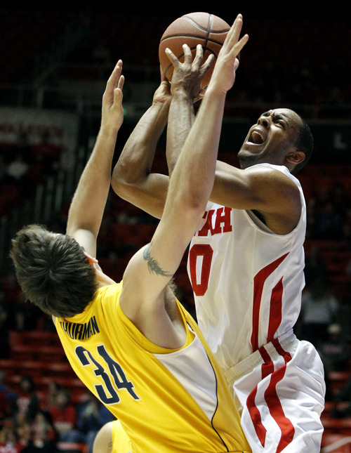 Utah guard Chris Hines (0) shoots against California forward Robert Thurman (34) during the second half of an NCAA college basketball game on Thursday, Feb. 23, 2012, in Salt Lake City.  California won 60-46. (AP Photo/Jim Urquhart)