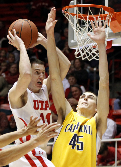 Utah guard Alex Mortensen (11) looks to pass against California forward David Kravish (45) during the second half of an NCAA college basketball game Thursday, Feb. 23, 2012, in Salt Lake City. California won 60-46. (AP Photo/Jim Urquhart)
