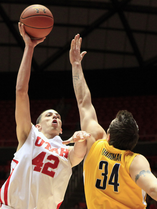 Utah center Jason Washburn (42) shoots over California forward Robert Thurman (34) during the second half of an NCAA college basketball game Thursday, Feb. 23, 2012, in Salt Lake City. California won 60-46. (AP Photo/Jim Urquhart)