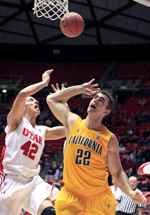 Utah center Jason Washburn (42) breaks up a shot attempt by California forward Harper Kamp (22) during the first half of an NCAA college basketball game on Thursday, Feb. 23, 2012, in Salt Lake City.  (AP Photo/Jim Urquhart)