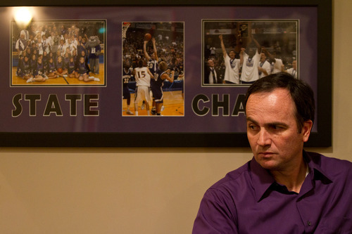 Chet Strange  |  Special to the Tribune  Gordon Scott Hayward sits in the Hayward's Brownsburg, Ind., home.  Behind him, a photo collage from the Brownsburg Bulldogs' State Championship win in 2008.
