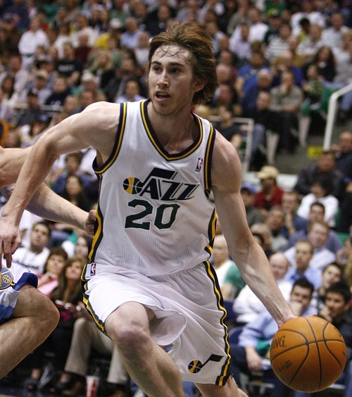 Djamila Grossman  |  The Salt Lake Tribune  The Utah Jazz' Gordon Hayward (20) drives toward the basket during a game against the Denver Nuggets at Energy Solutions Arena in Salt Lake City, Utah, on Wednesday, April 13, 2011.