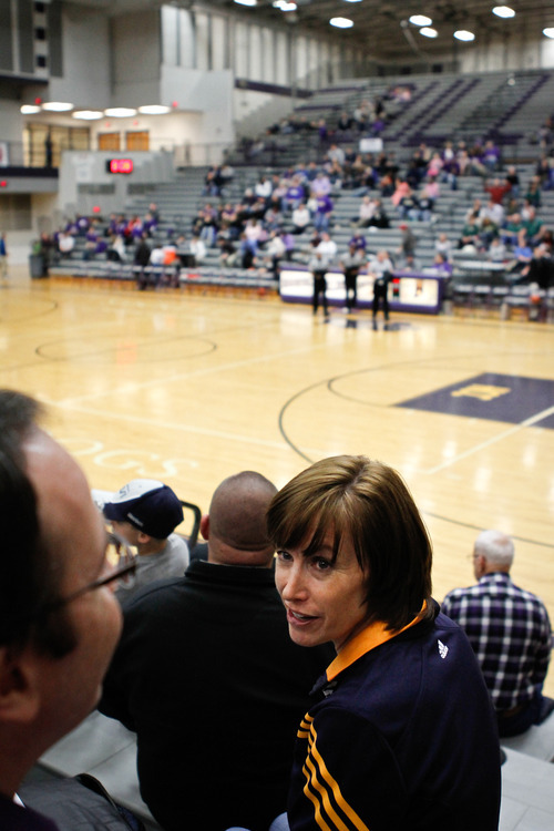 Chet Strange  |  Special to the Tribune  Jody Hayward talks to her husband Gordon during a Brownsburg Bulldogs basketball game.  Aside from getting their son, current Utah Jazz forward Gordon Hayward into sports at an early age, they instilled in him a strong sense of family and religious values.