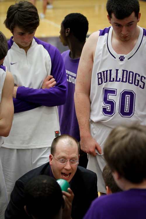 Chet Strange  |  Special to the Tribune  Brownsburg Bulldogs head coach Joshua Kendrick talks to players during a time out against Westfield High School on Feb. 3 at Brownsburg High School.  Kendrick coached Gordon Hayward through four years of high school basketball, leading his team to a 4A state championship in 2008.