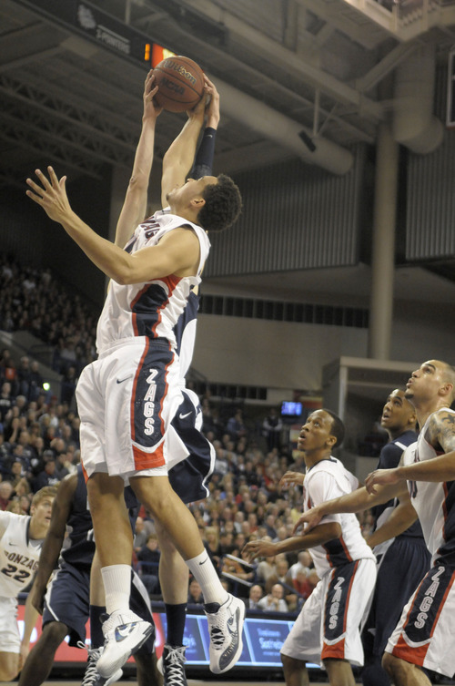 Gonzaga's Elias Harris pulls grabs the rebound from Brigham Young defenders, in the first half of an NCAA college basketball game, Thursday, Feb. 23, 2012, in Spokane, Wash. (AP Photo/Jed Conklin)