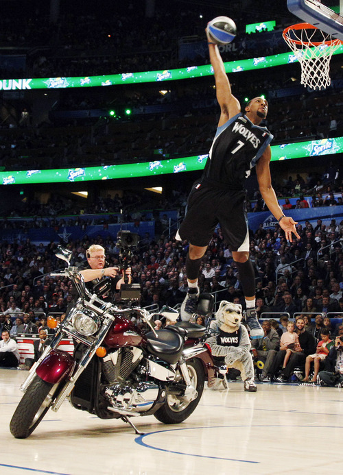 Minnesota Timberwolves' Derrick Williams jumps over a motorcycle during the NBA basketball All-Star Slam Dunk Contest in Orlando, Fla., Saturday, Feb. 25, 2012. (AP Photo/Lynne Sladky)