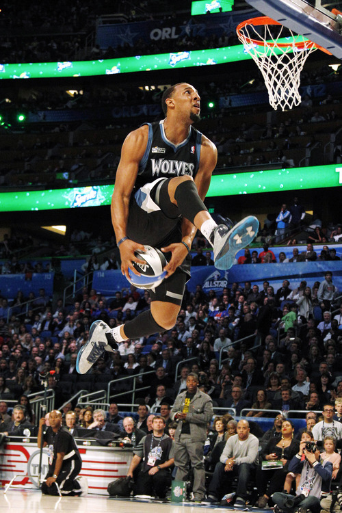 Minnesota Timberwolves' Derrick Williams performs his attempt during the NBA basketball All-Star Slam Dunk contest, Saturday, Feb. 25, 2012, in Orlando, Fla. (AP Photo/Lynne Sladky)