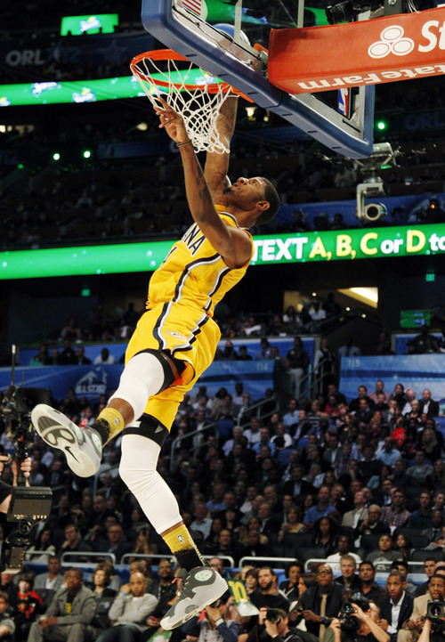 Out of nowhere jazzs jeremy evans jumps to nba dunk title the indiana pacers paul george dunks during the nba basketball all star slam dunk contest voltagebd Gallery