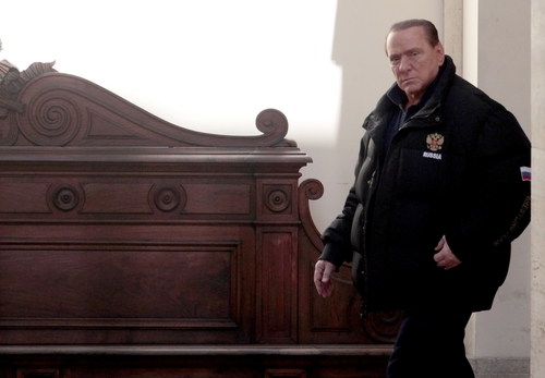 Former Italian Premier Silvio Berlusconi leaves his residence of Palazzo Grazioli in Rome, Saturday, Feb. 25, 2012. Defense lawyers for Silvio Berlusconi are making their final arguments in the former premier's corruption trial before the court begins deliberations. A verdict in the case is expected later Saturday but is unlikely to have any lasting legal force due to statute of limitations. Berlusconi is accused of having paid a British lawyer $600,000 to lie in two 1990s trials related to the billionaire media mogul's business dealings. (AP Photo/Gregorio Borgia)