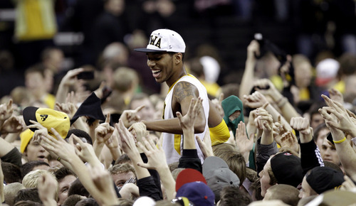 Iowa guard Devyn Marble celebrates with fans after his team's 67-66 win over Wisconsin in an NCAA college basketball game, Thursday, Feb. 23, 2012, in Iowa City, Iowa. (AP Photo/Charlie Neibergall)