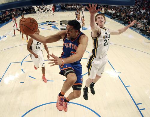 New York Knicks' Landry Fields (2), of Team Shaq, shoots past Utah Jazz's Gordon Hayward (20), of Team Chuck, during the NBA All-Star Rising Stars Challenge basketball game in Orlando, Fla. Friday, Feb. 24, 2012. (AP Photo/Mike Ehrmann, Pool)