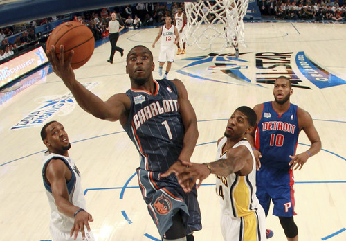 Charlotte Hornets' Kemba Walker (1), of Team Shaq , shoots past Indiana Pacers' Paul George (24), of Team Chuck, during the NBA All-Star Rising Stars Challenge basketball game in Orlando, Fla. Friday, Feb. 24, 2012. (AP Photo/Mike Ehrmann, Pool)