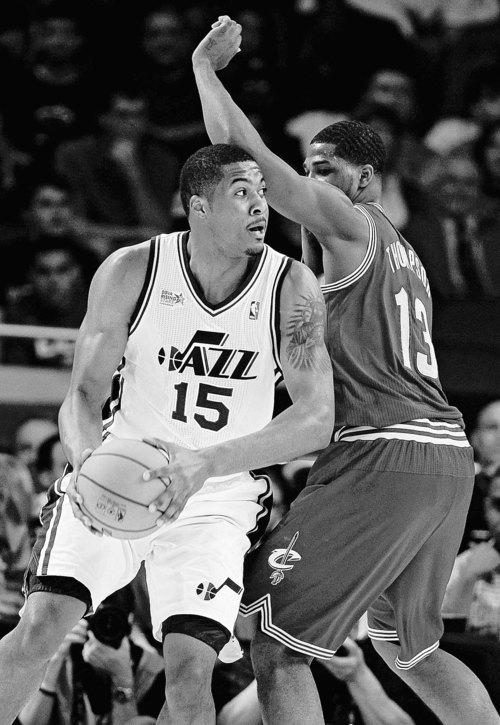 Utah Jazz's Derrick Favors (15), on Team Chuck, drives around Cleveland Cavaliers' Tristan Thompson (13), on Team Shaq, during the NBA All-Star Rising Stars Challenge basketball game in Orlando, Fla. Friday, Feb. 24, 2012. (AP Photo/Chris O'Meara)