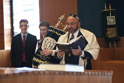 Perry Berger, left, and Rabbi Joshua Aaronson, right, of Temple Har Shalom in Park City, take part in the bar mitzvah of Charlie Barth, center, last year at the Park City synagogue. In Judaism, a bar mitzvah signifies entry into Jewish adulthood. Courtesy Deborah DeKoff