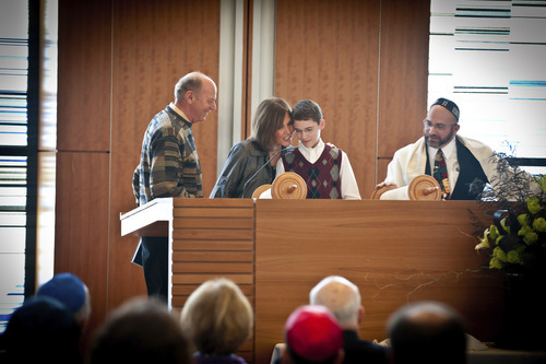 Jerry and Marilyn Lipson, left, participate in bar mitzvah of Charlie Barth along with Rabbi Joshua Aaronson at Park City's Temple Har Shalom last year. In Judaism, a bar mitzvah signifies entry into Jewish adulthood. Courtesy Deborah DeKoff