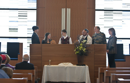 Josh Berger, Abby Berger, left, and Jerry and Marilyn Lipson, right, participate in the bar mitzvah of Charlie Barth with Rabbi Joshua Aaronson at Temple Har Shalom in Park City last year. In Judaism, a bar mitzvah signifies entry into Jewish adulthood. Courtesy Deborah DeKoff