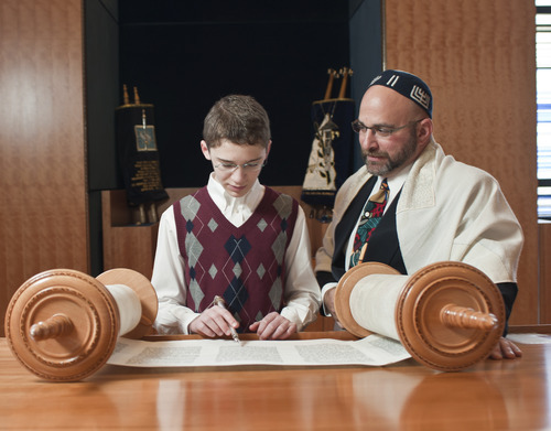 Charlie Barth, left, prepares for his bar mitzvah with Temple Har Shalom Rabbi Joshua Aaronson in Park City last year. In Judaism, a bar mitzvah signifies entry into Jewish adulthood. Courtesy Deborah DeKoff