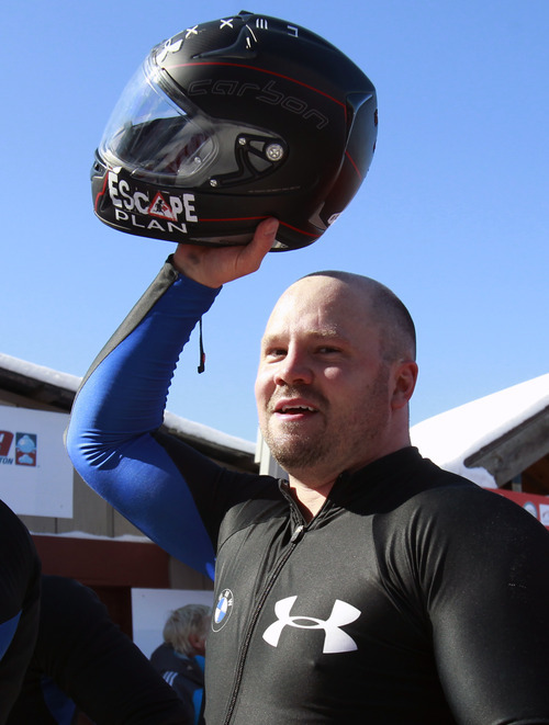 United States pilot Steven Holcomb reacts after his team won the men's four-man bobsled world championships in Lake Placid, N.Y., Sunday, Feb. 26, 2012. (AP Photo/Mike Groll)