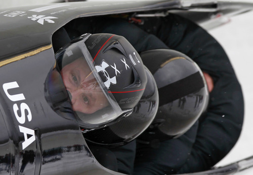 USA's pilot Steven Holcomb, front, with pushers Justin Olsen, Steven Langton and brakeman Curtis Tomasevicz, compete in the second heat in the men's four-man Bobsled World Championships in Lake Placid, N.Y., on Saturday, Feb. 25, 2012. (AP Photo/Mike Groll)