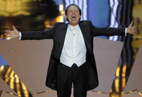 Billy Crystal performs during the 84th Academy Awards on Sunday, Feb. 26, 2012, in the Hollywood section of Los Angeles. (AP Photo/Mark J. Terrill)