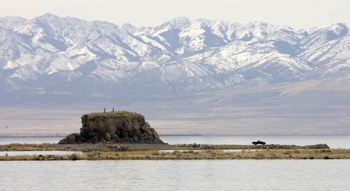 Paul Fraughton | The Salt Lake Tribune  People climb on top of Black Rock on the Great Salt Lake near I-80 on Wednesday.