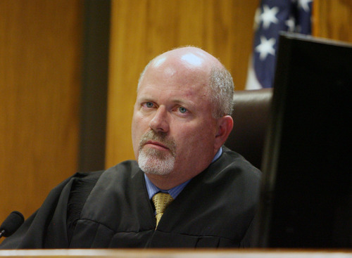 Steve Griffin     The Salt Lake Tribune  Judge Reed S. Parkin listens to attorney Grant Nagamatsu during during a sentencing hearing for Mark Vreeland at the Justice Court in Orem on Monday, Feb. 27, 2012. Vreeland is charged with impersonating an immigration officer.