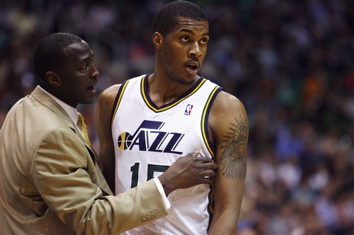 Tribune file photo  Utah coach Tyrone Corbin is charged with helping young players such as Derrick Favors improve.