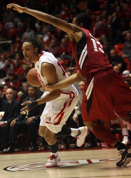 Kim Raff  |  The Salt Lake Tribune University of Utah player Dijon Farr drives the basket past Stanford player Josh Owens during a game at the Huntsman Center in Salt Lake City, Utah on February 25, 2012.  Utah went on to win 58-57.