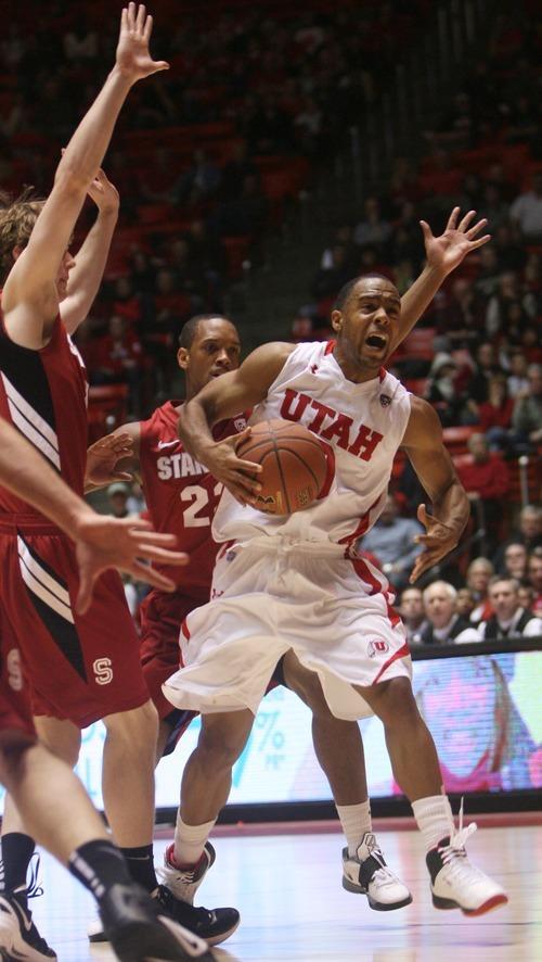 Kim Raff  |  The Salt Lake Tribune University of Utah player Chris Hines drives past the Stanford defense during a game at the Huntsman Center in Salt Lake City, Utah on February 25, 2012. Utah went on to win 58-57.