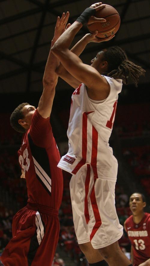 Kim Raff  |  The Salt Lake Tribune University of Utah player Dijon Farr takes a shot as Stanford player Dwight Powell defends during the first half at the Huntsman Center in Salt Lake City, Utah on February 25, 2012.