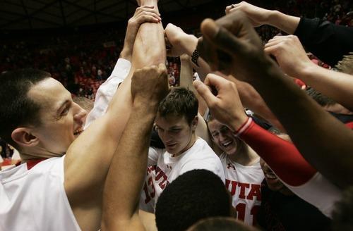 Kim Raff  |  The Salt Lake Tribune University of Utah players celebrate beating Stanford 58-57 at the Huntsman Center in Salt Lake City, Utah on February 25, 2012.