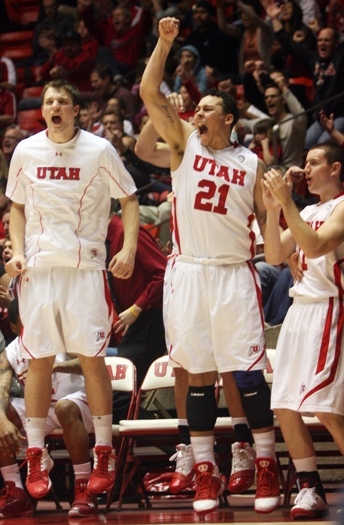 Kim Raff  |  The Salt Lake Tribune University of Utah players celebrate taking a late lead over Stanford at the Huntsman Center in Salt Lake City, Utah on February 25, 2012. Utah went on to win 58-57.