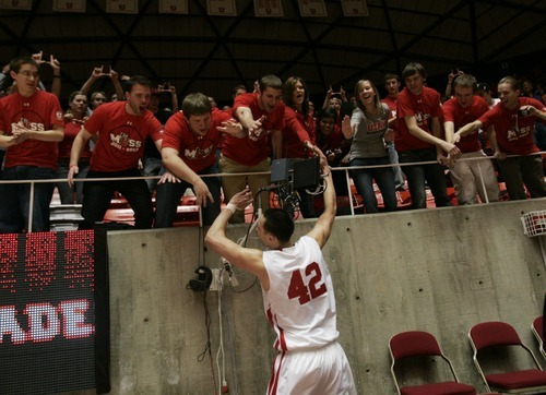 Kim Raff  |  The Salt Lake Tribune University of Utah player Jason Washburn celebrates with fans after defeating Stanford 58-57 at the Huntsman Center in Salt Lake City, Utah on February 25, 2012.